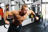 Athlete during a suspension training — Stock Photo