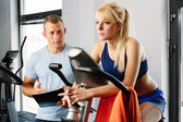Personal trainer and young woman — Stock Photo