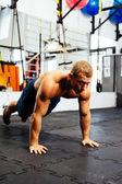Athlete practicing suspension training — Stock Photo