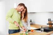 Couple preparing some food together — Stock Photo