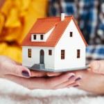 Couple holding house miniature — Stock Photo #68860773