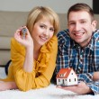 Young couple showing keys — Stock Photo #68860835
