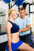 Woman with personal trainer — Stock Photo
