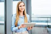 Pretty manager with a tablet — Stock Photo