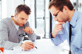 Two architects busy with creative work — Stock Photo