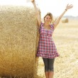 Young girl near haystack — Stock Photo #58939227
