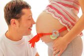 Man and pregnant female belly — Stock Photo