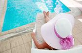 Girl near swimming pool — Stock Photo