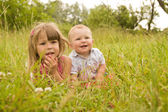 Brother and sister  in field — Stock Photo