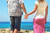 Boy and girl couple on the beach — Stock Photo