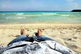 Feet on the sand near the sea — Stock Photo