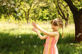 Girl with soap bubbles — Stock Photo