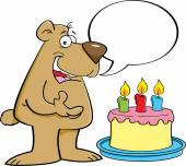 Cartoon bear with a speech balloon and a birthday cake. — Stock Vector