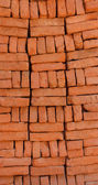 Supply of stacked orange bricks — Stock Photo