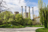 Power plant in spring green landscape — Stock Photo
