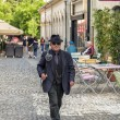 Elegant Chimney sweep walking in downtown of Bucharest — Stock Photo #73393263