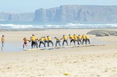 Surfers doing excersises — Stock Photo