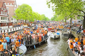 Amsterdam canals full of boats and people — Stock Photo