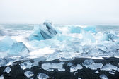 Ice rocks on a black sand beach in Iceland — Stock Photo