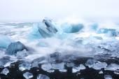 Ice rocks on a black sand beach in Iceland — Stock Photo