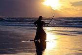 Samurai at sunset on beach — ストック写真