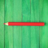 Red Pencil on Green Background old retro vintage style — Stock Photo