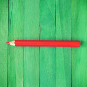 Rood potlood op groene achtergrond oude retro vintage stijl — Stockfoto