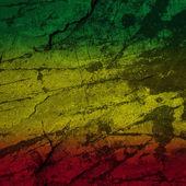 Красный, желтый, зеленый Раста флаг на каменной стены — Стоковое фото