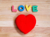 Valentines Day background red heart on wooden background — Stock Photo