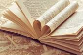 Love heart in a book with filter effect retro vintage style — Stock Photo