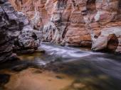 Creek flowing over the rocks — Stock Photo