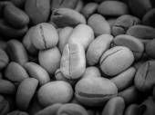 Black and white coffee beans — Stock Photo