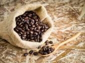 Coffee beans in a bag with filter effect retro vintage style — Stock Photo