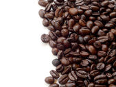 Brown coffee beans isolated on white background — Stock Photo