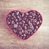 Heart shaped coffee beans with filter effect retro vintage style — Stock Photo