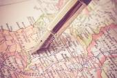 Pen and a map  with filter effect retro vintage style — Stock Photo
