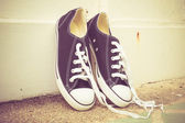 Black sneakers with filter effect retro vintage style — Stock Photo