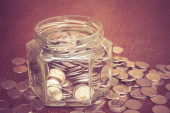 Money in the glass with filter effect retro vintage style — Stock Photo
