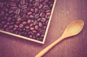 Coffee beans and wooden spoon with filter effect retro vintage s — Stock Photo