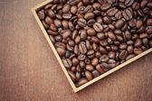 Grãos de café com filtro efeito estilo vintage retrô — Fotografia Stock