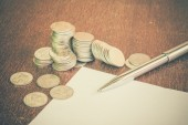 Pen and coins with filter effect retro vintage style — Stock Photo