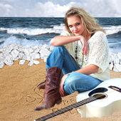 Female Guitarist on Beach — Stock Photo