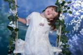 Girl on Swing with Flowers — Stock Photo