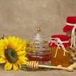 Постер, плакат: Bee Hive jar with honeyand wand Sunflowers Jar of Peanuts