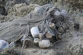 Fishing net lying on the shore — Foto de Stock