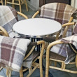 Table with plaid on chairs — Stock Photo #65329949