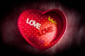 """Heart-shaped gift box and text """"LOVE"""" middle box — Stock Photo"""
