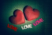 """Two red heart and three text """"LOVE"""" on the texture background — Stock Photo"""