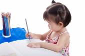 Asian girl drawing picture — Stock Photo