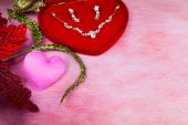 Pink heart-shaped and jewelry in red velvet box — Stock Photo